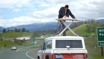 Extreme-Ironing-funny-on-car-roof